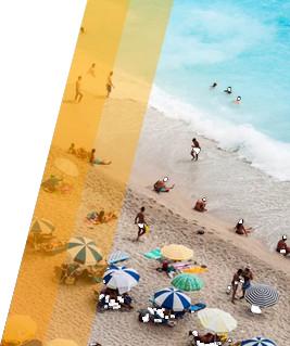 People enjoying and sunbathing on the beach shore